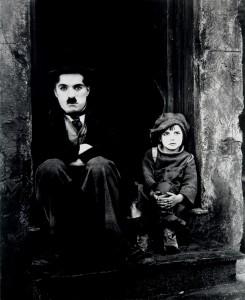 "Charlie Chaplin and Jackie Coogan in ""The Kid."""
