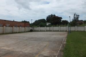 The unused basketball court.